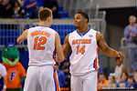 Florida Gators guard Zach Hodskins and Lexx Edwards celebrate their win as the University of Florida Gators win at home over the Vermont Catamounts 86-62.  Florida Gators vs Vermont Catamounts.  November 25th, 2015. Gator Country photo by David Bowie.