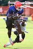 Photo by Tim Casey <br /> <br /> Sophomore tight end Cornelius Ingram (7- Hawthorne, Fla.) catches a pass over freshman safety Dorian Munroe (34- Miami) during the University of Florida football team's third day of summer practice on Tuesday, August 7, 2006 in Gainesville, Fla.