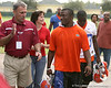 photo by Tim Casey<br /> <br /> St. Augustine High School football coach Joey Wiles speaks with UF sophomore running back Brandon James after the Gators practiced on Sunday, December 30, 2007 at Disney's Wide World of Sports Complex in Lake Buena Vista, Fla.