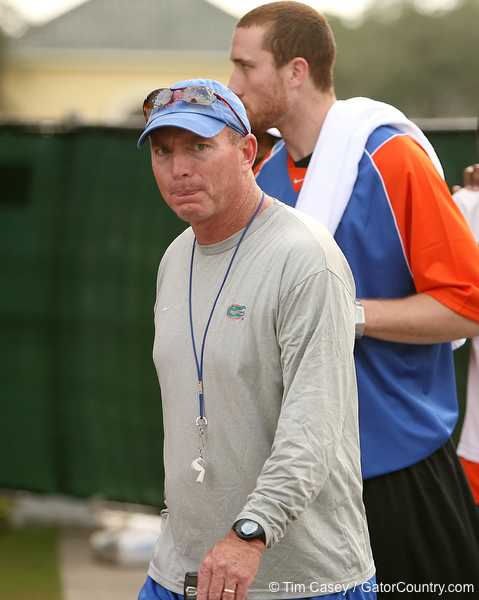 """photo by Tim Casey<br /> <br /> UF safeties coach John """"Doc"""" Holliday leaves the field after the Gators practiced on Sunday, December 30, 2007 at Disney's Wide World of Sports Complex in Lake Buena Vista, Fla."""