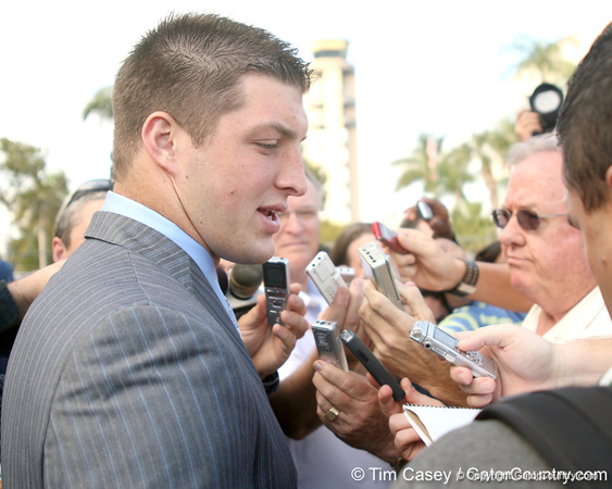photo by Tim Casey<br /> <br /> Florida junior quarterback Tim Tebow talks to media after the Gators arrived for the BCS Championship Game on Friday, January 2, 2009 at Fort Lauderdale-Hollywood International Airport in Fort Lauderdale, Fla.