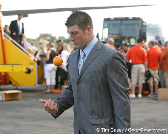 photo by Tim Casey<br /> <br /> Florida junior quarterback Tim Tebow tosses an orange after the Gators arrived for the BCS Championship Game on Friday, January 2, 2009 at Fort Lauderdale-Hollywood International Airport in Fort Lauderdale, Fla.