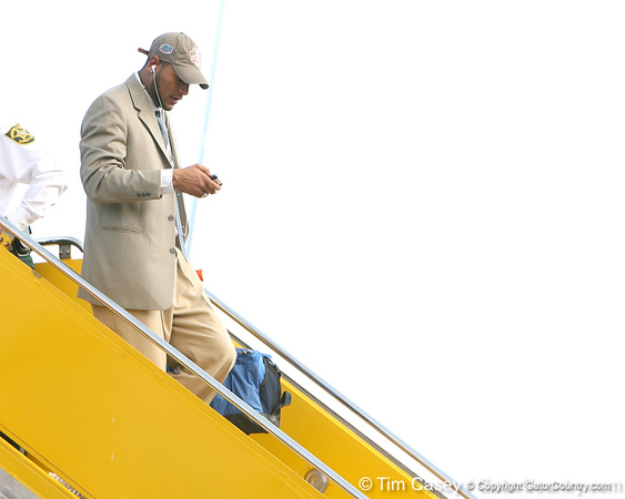 photo by Tim Casey<br /> <br /> Florida senior wide receiver Louis Murphy disembarks from the team plane after the Gators arrived for the BCS Championship Game on Friday, January 2, 2009 at Fort Lauderdale-Hollywood International Airport in Fort Lauderdale, Fla.