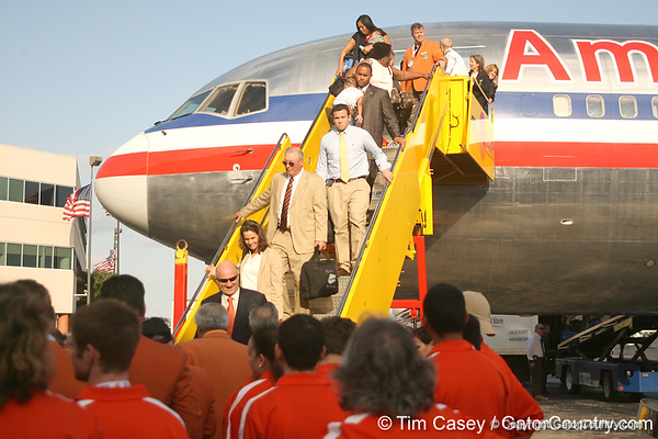 photo by Tim Casey<br /> <br /> Members of the Florida staff disembark after the Gators arrived for the BCS Championship Game on Friday, January 2, 2009 at Fort Lauderdale-Hollywood International Airport in Fort Lauderdale, Fla.