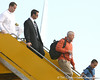 photo by Tim Casey<br /> <br /> Florida athletics director Jeremy Foley disembarks from the team plane after the Gators arrived for the BCS Championship Game on Friday, January 2, 2009 at Fort Lauderdale-Hollywood International Airport in Fort Lauderdale, Fla.