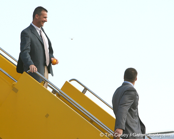 photo by Tim Casey<br /> <br /> Florida head coach Urban Meyer disembarks from the team plane after the Gators arrived for the BCS Championship Game on Friday, January 2, 2009 at Fort Lauderdale-Hollywood International Airport in Fort Lauderdale, Fla.