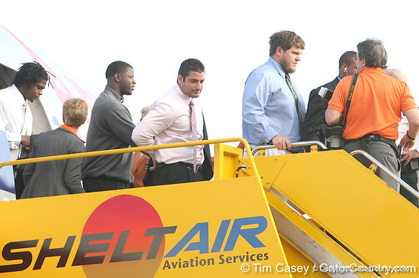 photo by Tim Casey<br /> <br /> Florida redshirt senior offensive lineman Jim Tartt disembarks from the team plane after the Gators arrived for the BCS Championship Game on Friday, January 2, 2009 at Fort Lauderdale-Hollywood International Airport in Fort Lauderdale, Fla.