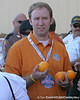 photo by Tim Casey<br /> <br /> An Orange Bowl volunteer holds oranges before the Gators arrived for the BCS Championship Game on Friday, January 2, 2009 at Fort Lauderdale-Hollywood International Airport in Fort Lauderdale, Fla.