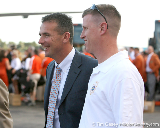 photo by Tim Casey<br /> <br /> Florida head coach Urban Meyer laughs after the Gators arrived for the BCS Championship Game on Friday, January 2, 2009 at Fort Lauderdale-Hollywood International Airport in Fort Lauderdale, Fla.