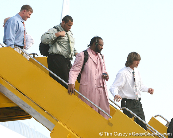photo by Tim Casey<br /> <br /> Florida redshirt senior long snapper James Smith, Florida redshirt sophomore defensive tackle Terron Sanders, Florida junior linebacker Brandon Spikes and Florida junior wide receiver Riley Cooper disembark from the team plane after the Gators arrived for the BCS Championship Game on Friday, January 2, 2009 at Fort Lauderdale-Hollywood International Airport in Fort Lauderdale, Fla.