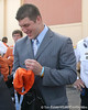 photo by Tim Casey<br /> <br /> Florida junior quarterback Tim Tebow signs an autograph for a police officer after the Gators arrived for the BCS Championship Game on Friday, January 2, 2009 at Fort Lauderdale-Hollywood International Airport in Fort Lauderdale, Fla.