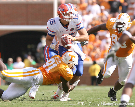 photo by Tim Casey<br /> <br /> Florida junior quarterback Tim Tebow completes a nine-yard pass to Kestahn Moore while being tackled during the first half of the Gators' game against the Tennessee Volunteers on Saturday, September 20, 2008 at Neyland Stadium in Knoxville, Tenn.