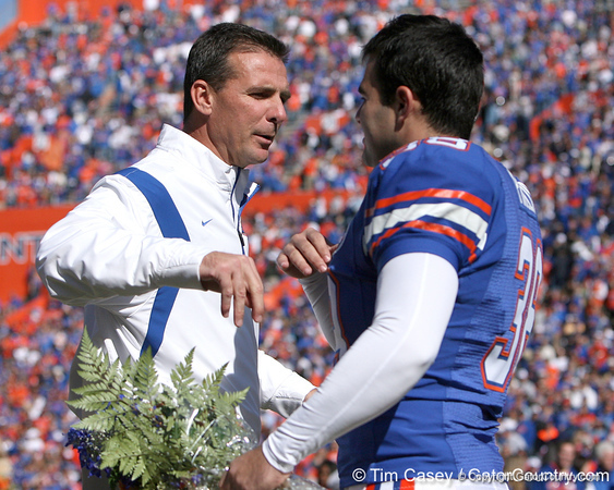 photo by Tim Casey<br /> <br /> Florida head coach Urban Meyer and Florida senior kicker Jonathan Phillips participate in the Senior Day ceremony before the Gators' 70-19 win against The Citadel Bulldogs on Saturday, November 22, 2008 at Ben Hill Griffin Stadium in Gainesville, Fla. UF led 49-6 at halftime.