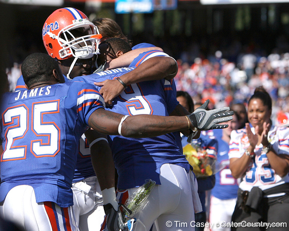 photo by Tim Casey<br /> <br /> Brandon James, Deonte Thompson, Carl Moore and Riley Cooper hug Louis Murphy during the Senior Day ceremony before the Gators' 70-19 win against The Citadel Bulldogs on Saturday, November 22, 2008 at Ben Hill Griffin Stadium in Gainesville, Fla. UF led 49-6 at halftime.