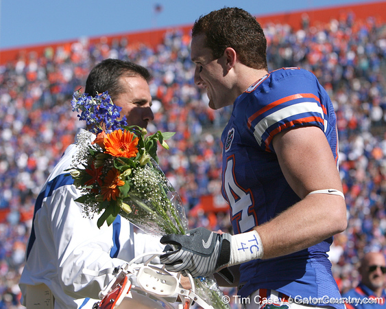 photo by Tim Casey<br /> <br /> Florida head coach Urban Meyer and Florida redshirt senior tight end Tate Casey participate in the Senior Day ceremony before the Gators' 70-19 win against The Citadel Bulldogs on Saturday, November 22, 2008 at Ben Hill Griffin Stadium in Gainesville, Fla. UF led 49-6 at halftime.
