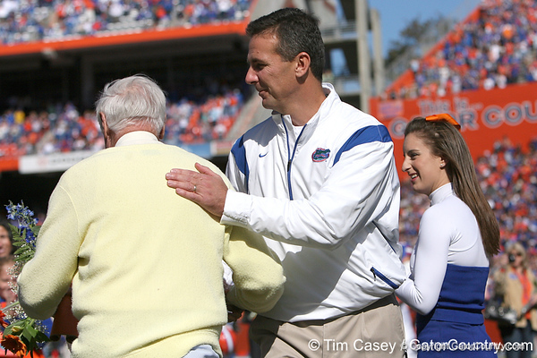 "photo by Tim Casey<br /> <br /> Florida head coach Urban Meyer and George ""Mr. Two Bits"" Edmondson participate in the Senior Day ceremony before the Gators' 70-19 win against The Citadel Bulldogs on Saturday, November 22, 2008 at Ben Hill Griffin Stadium in Gainesville, Fla. UF led 49-6 at halftime."