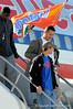 (Casey Brooke Lawson / Gator Country) Earl Okine, Head Coach Urban Meyer and Bobby Kane walk down the airplane stairs at the Gainesville Regional Airport in Gainesville, Fla., on January 9, 2009.