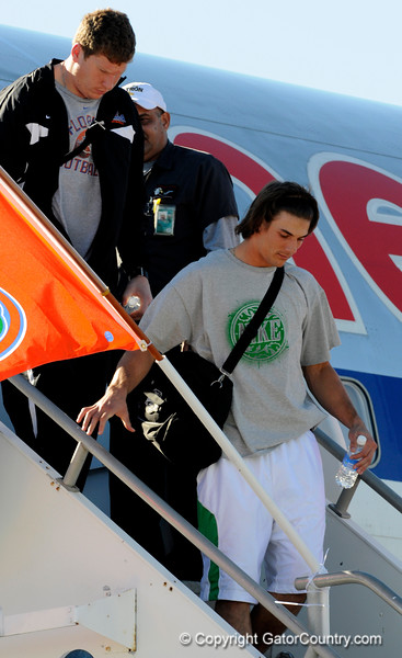 (Casey Brooke Lawson / Gator Country) Phil Trautwein and Riley Cooper return from Miami, after winning the 2008 BCS National Championship, to the Gainesville Regional Airport in Gainesville, Fla., on January 9, 2009.