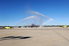 (Casey Brooke Lawson / Gator Country) Fire trucks spray water over the American Airlines plane that holds the University of Florida football team who has just returned from Miami, after winning the 2008 BCS National Championship, in Gainesville, Fla., on January 9, 2009.
