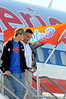 (Casey Brooke Lawson / Gator Country) Bobby Kane and Head Coach Urban Meyer walk down the airplane stairs at the Gainesville Regional Airport in Gainesville, Fla., on January 9, 2009.