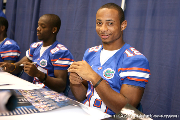 Florida redshirt freshman wide receiver T.J. Lawrence signs autographs during the Gators' annual preseason fan day on Sunday, August 16, 2009 at the Stephen C. O'Connell Center in Gainesville, Fla. / Gator Country photo by Tim Casey