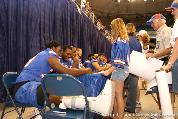 Florida freshman Xavier Nixon signs autographs during the Gators' annual preseason fan day on Sunday, August 16, 2009 at the Stephen C. O'Connell Center in Gainesville, Fla. / Gator Country photo by Tim Casey