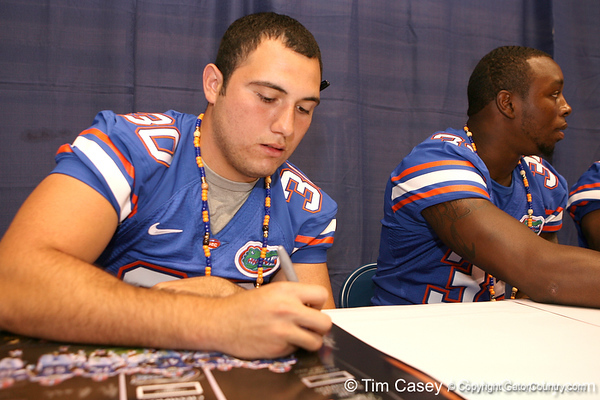 Florida redshirt junior linebacker Chris Pintado signs autographs during the Gators' annual preseason fan day on Sunday, August 16, 2009 at the Stephen C. O'Connell Center in Gainesville, Fla. / Gator Country photo by Tim Casey
