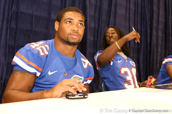Florida redshirt junior Miguel Carodine signs autographs during the Gators' annual preseason fan day on Sunday, August 16, 2009 at the Stephen C. O'Connell Center in Gainesville, Fla. / Gator Country photo by Tim Casey