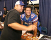 Florida senior quarterback Tim Tebow signs autographs during the Gators' annual preseason fan day on Sunday, August 16, 2009 at the Stephen C. O'Connell Center in Gainesville, Fla. / Gator Country photo by Tim Casey