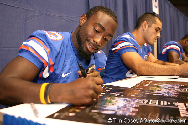Florida redshirt sophomore running back Chris Rainey signs autographs during the Gators' annual preseason fan day on Sunday, August 16, 2009 at the Stephen C. O'Connell Center in Gainesville, Fla. / Gator Country photo by Tim Casey