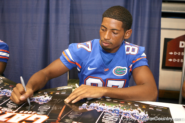 Florida redshirt freshman Josh Postell signs autographs during the Gators' annual preseason fan day on Sunday, August 16, 2009 at the Stephen C. O'Connell Center in Gainesville, Fla. / Gator Country photo by Tim Casey