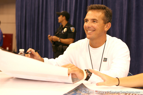 Florida head coach Urban Meyer signs autographs during the Gators' annual preseason fan day on Sunday, August 16, 2009 at the Stephen C. O'Connell Center in Gainesville, Fla. / Gator Country photo by Tim Casey