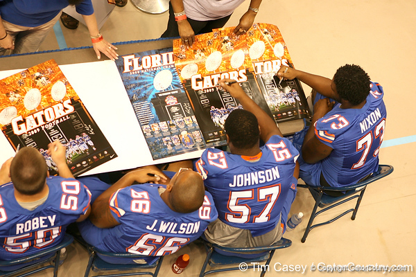 Florida offensive lineman sign autographs during the Gators' annual preseason fan day on Sunday, August 16, 2009 at the Stephen C. O'Connell Center in Gainesville, Fla. / Gator Country photo by Tim Casey
