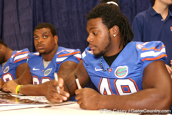 Florida senior defensive end Jermaine Cunningham signs autographs during the Gators' annual preseason fan day on Sunday, August 16, 2009 at the Stephen C. O'Connell Center in Gainesville, Fla. / Gator Country photo by Tim Casey