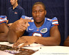 Florida junior defensive end Carlos Dunlap signs autographs during the Gators' annual preseason fan day on Sunday, August 16, 2009 at the Stephen C. O'Connell Center in Gainesville, Fla. / Gator Country photo by Tim Casey