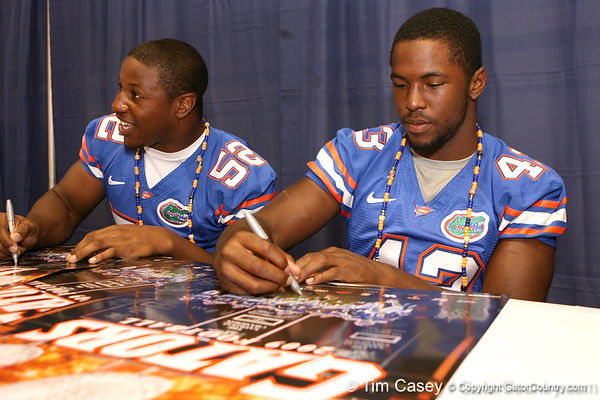 Florida freshman linebackers  Jonathan Bostic and Jelani Jenkins sign autographs during the Gators' annual preseason fan day on Sunday, August 16, 2009 at the Stephen C. O'Connell Center in Gainesville, Fla. / Gator Country photo by Tim Casey