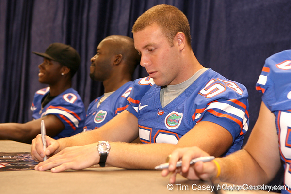 Florida redshirt senior Mike Williamson signs autographs during the Gators' annual preseason fan day on Sunday, August 16, 2009 at the Stephen C. O'Connell Center in Gainesville, Fla. / Gator Country photo by Tim Casey