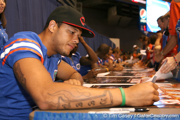 Florida senior wide receiver Carl Moore signs autographs during the Gators' annual preseason fan day on Sunday, August 16, 2009 at the Stephen C. O'Connell Center in Gainesville, Fla. / Gator Country photo by Tim Casey
