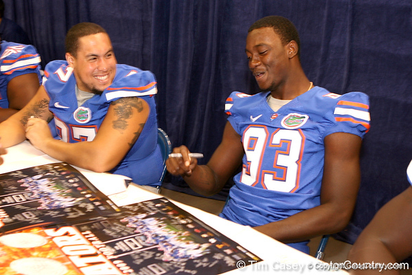 Florida junior defensive tackle Edwin Herbert jokes with Kedric Johnson during the Gators' annual preseason fan day on Sunday, August 16, 2009 at the Stephen C. O'Connell Center in Gainesville, Fla. / Gator Country photo by Tim Casey