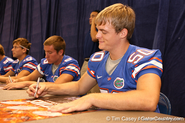 Florida redshirt freshman long snapper Cody Hampton signs autpgraphs during the Gators' annual preseason fan day on Sunday, August 16, 2009 at the Stephen C. O'Connell Center in Gainesville, Fla. / Gator Country photo by Tim Casey