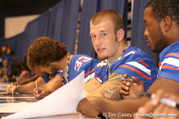 Florida redshirt freshman linebacker Brendan Beal signs autographs during the Gators' annual preseason fan day on Sunday, August 16, 2009 at the Stephen C. O'Connell Center in Gainesville, Fla. / Gator Country photo by Tim Casey