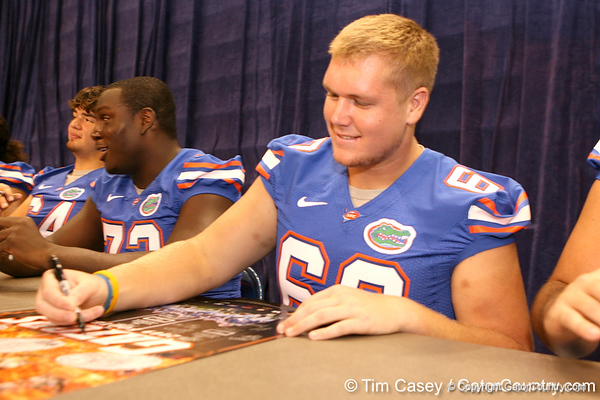 Florida sophomore offensive lineman William Steinmann signs autographs during the Gators' annual preseason fan day on Sunday, August 16, 2009 at the Stephen C. O'Connell Center in Gainesville, Fla. / Gator Country photo by Tim Casey