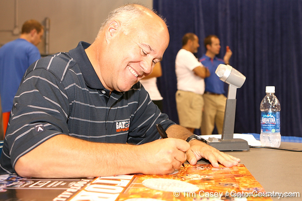 Florida radio announcer Mick Hubert signs autographs during the Gators' annual preseason fan day on Sunday, August 16, 2009 at the Stephen C. O'Connell Center in Gainesville, Fla. / Gator Country photo by Tim Casey
