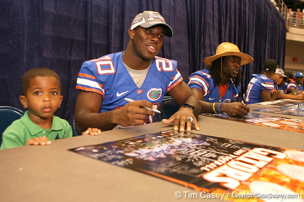 Florida redshirt senior safety Dorian Munroe signs autographs during the Gators' annual preseason fan day on Sunday, August 16, 2009 at the Stephen C. O'Connell Center in Gainesville, Fla. / Gator Country photo by Tim Casey