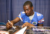 Florida freshman wide receiver Andre Debose signs autographs during the Gators' annual preseason fan day on Sunday, August 16, 2009 at the Stephen C. O'Connell Center in Gainesville, Fla. / Gator Country photo by Tim Casey