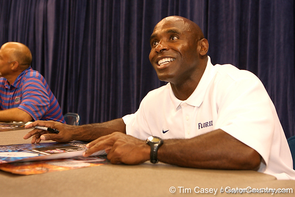 Florida associate head coach/ defensive coordinator/ linebackers coach Charlie Strong signs autographs during the Gators' annual preseason fan day on Sunday, August 16, 2009 at the Stephen C. O'Connell Center in Gainesville, Fla. / Gator Country photo by Tim Casey