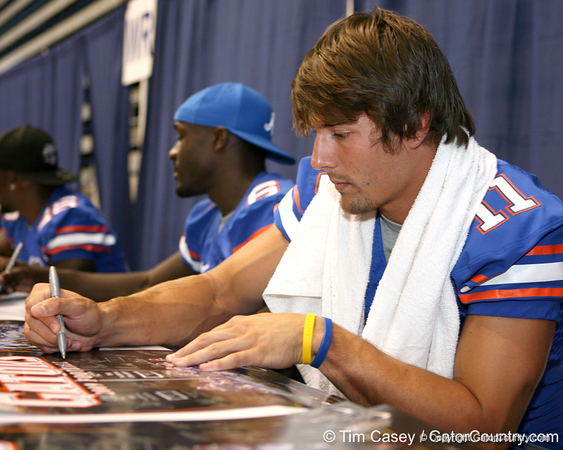 Florida senior wide receiver Riley Cooper signs autographs during the Gators' annual preseason fan day on Sunday, August 16, 2009 at the Stephen C. O'Connell Center in Gainesville, Fla. / Gator Country photo by Tim Casey