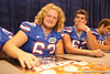 Florida freshman offensive linemen Cole Gilliam and Hayden Chance sign autographs during the Gators' annual preseason fan day on Sunday, August 16, 2009 at the Stephen C. O'Connell Center in Gainesville, Fla. / Gator Country photo by Tim Casey