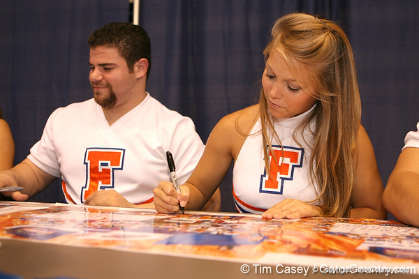 Florida cheerleaders sign autographs during the Gators' annual preseason fan day on Sunday, August 16, 2009 at the Stephen C. O'Connell Center in Gainesville, Fla. / Gator Country photo by Tim Casey
