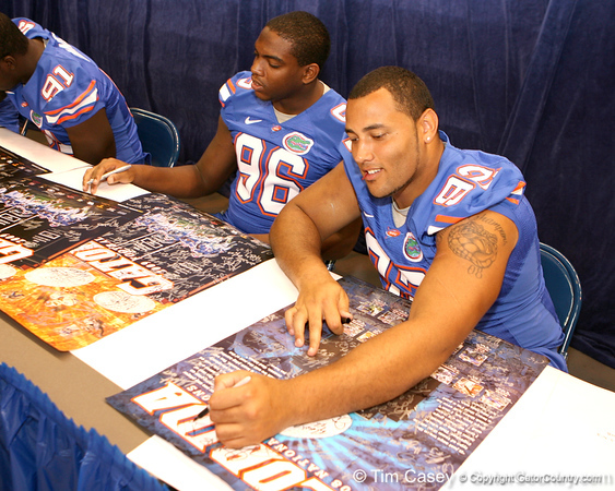 Florida redshirt junior defensive tackle Terron Sanders signs autographs during the Gators' annual preseason fan day on Sunday, August 16, 2009 at the Stephen C. O'Connell Center in Gainesville, Fla. / Gator Country photo by Tim Casey